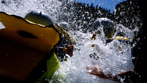 River rafters are hit with a face full of white water