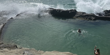 """This is known as the """"Secret Pools"""" in Laguna Beach and its only access is through a cave at *very low tide*. It's a dangerous spot if you don't know what you're doing. A young man got sucked into a blow hole when a rogue wave struck him and he unfortunately passed away. It is best to go with a local. #localsecrets"""