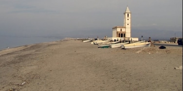 The most beautiful church n this deserted fisherman's beach with the boats up on the shore and no one in site - so very peaceful and beautiful I fell in love there and then.