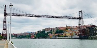 Getxo is a residential town close to Bilbao. Hardly anyone speaks English, but they are all very nice and there's tons a small places serving pintxos and drinks. This 'hanging bridge' is the Bizkaia Bridge, a transportation device that bring cars and people across the river between Getxo and Portugalete.
