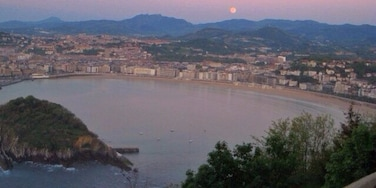 San Sebastián at sunset. Short hike or gondola ride to the top of the viewpoint. There's an awesome old school amusement park at the top of the mountain