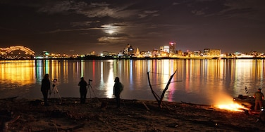 A group of friends and photographers gather on the west bank of the Mississippi River to shoot the December 2017 super moon rising over Memphis