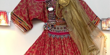 A beautiful Afghani dress on the wall of Kabul restaurant in Burlingame, California
