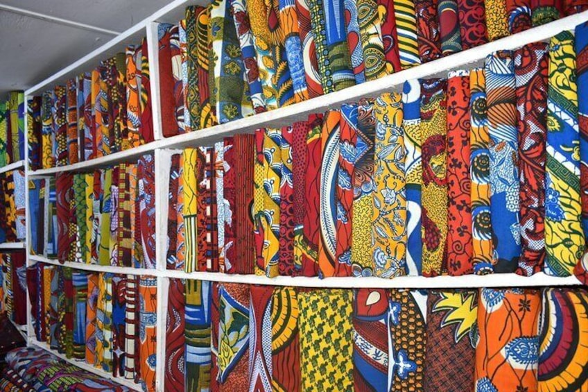 Show item 4 of 11. We visit a beautiful pagne market and learn the history of this colorful African/Dutch fabric!
