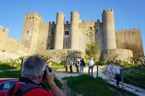 DUCA -Van Tour from Vicentine Coast to Óbidos, Nazaré, Alcobaça, Batalha, F...