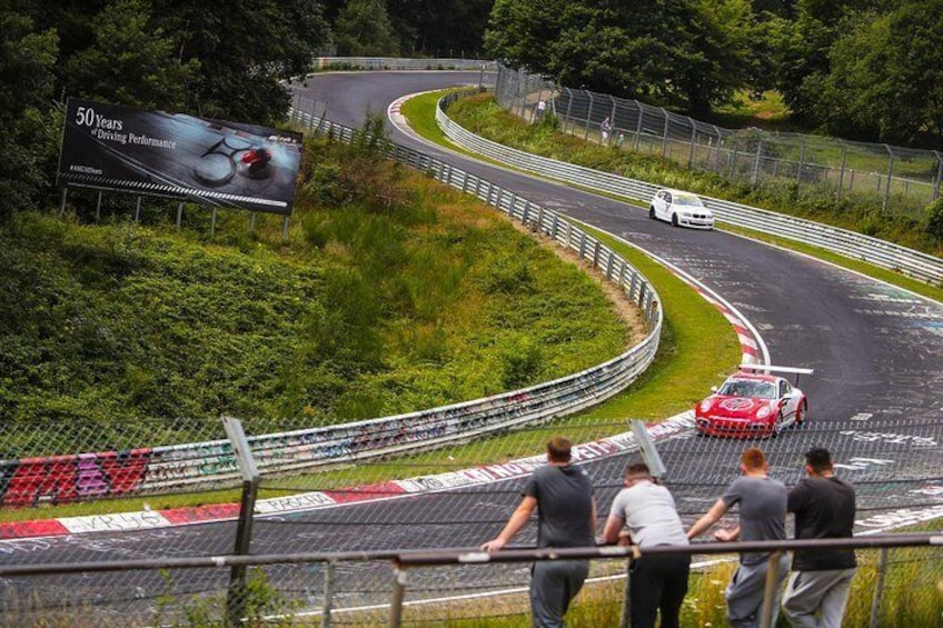 Watch the cars flying around the circuit