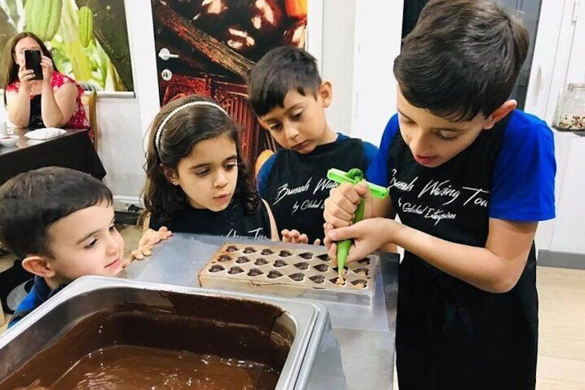 Learn how to make pralines during the chocolate workshop