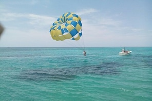 Parasailing Snorkeling and Glass Boat Adventure in Negril