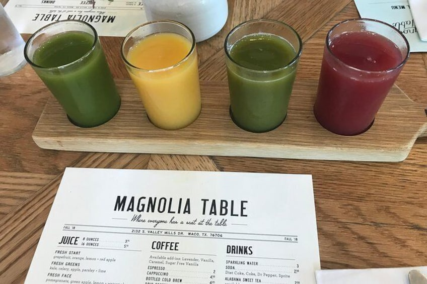Show item 3 of 21. Juice flight at the Magnolia Table