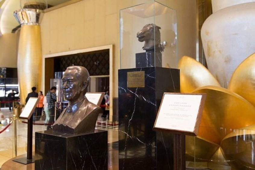 Show item 4 of 5. Stanley Ho Statue in Grand Lisboa: The king of Gambling
