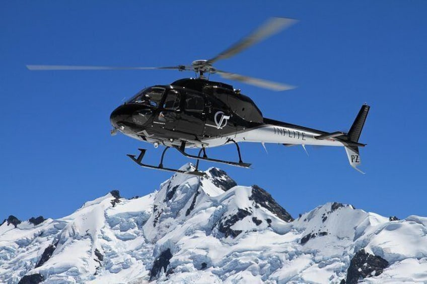 Show item 1 of 7. 25-Minute Helicopter flight including an alpine landing
