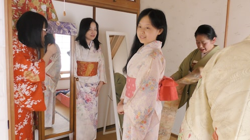 The Tea ceremony lesson with kimono in the serious tearoom.