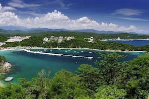 Huatulco Bay Day Trip with Catamaran Ride, Snorkeling and Beach Break from ...