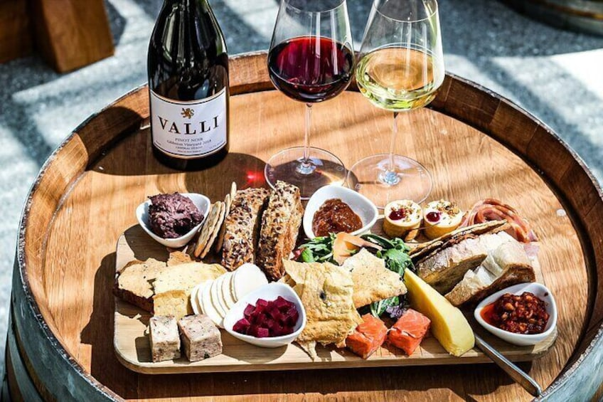 Tour includes a sumptuous platter and matching glass of wine.