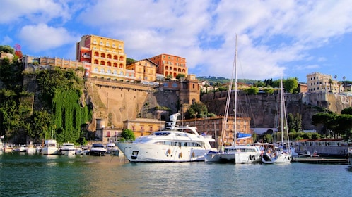 Scenic view of boats docked on the water in Italy