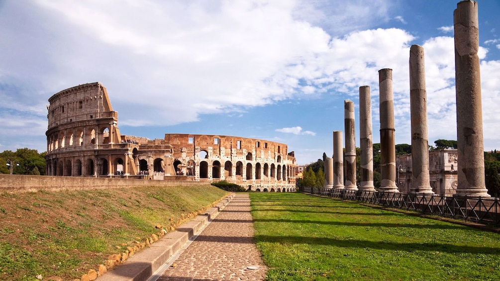 Landscape photo of the exterior of the Colosseum.