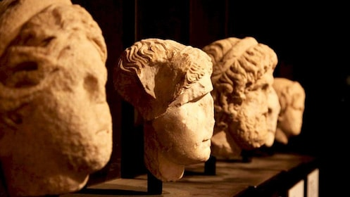 Sculpture of heads displayed in Rome