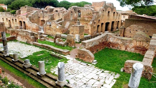View of Ostia buildings and Roman statues in Italy