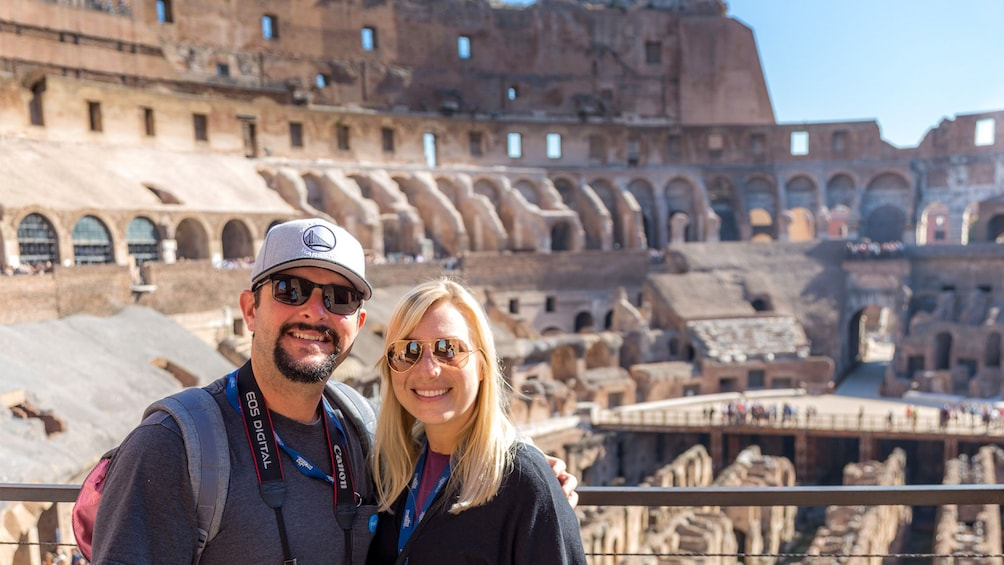 Show item 1 of 9. Couple visiting the Colosseum on a sunny day in Rome