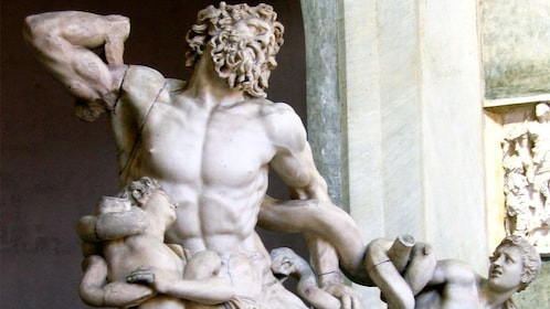 Famous statue of Laocoön and His Sons inside the Vatican in Rome Italy