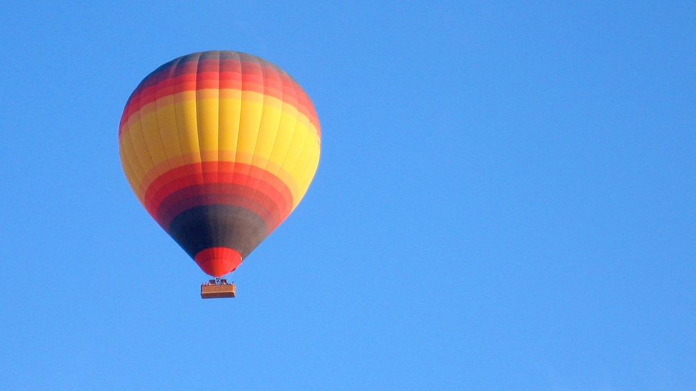 Show item 4 of 6. hot air balloon floating high overhead in Dubai