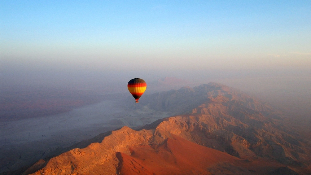 Show item 1 of 6. hot air balloon far above rocky hills of Dubai