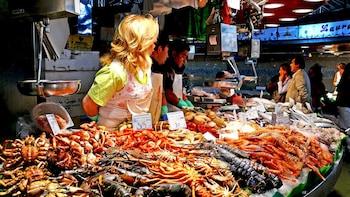 Indlæs billede 3 af 5. woman selling seafood at market in Barcelona