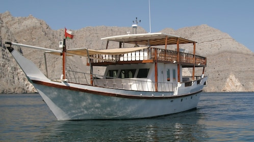Boat anchored on a river in Musandam