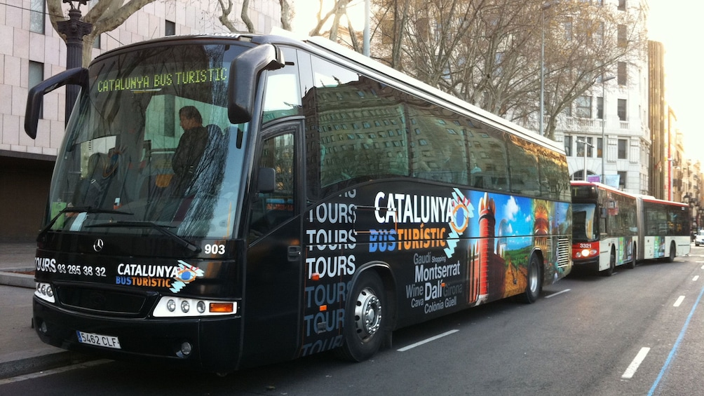 Show item 3 of 5. touring bus in Barcelona
