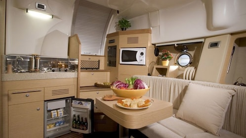 kitchen and dining area on a luxury speed boat in Dubai
