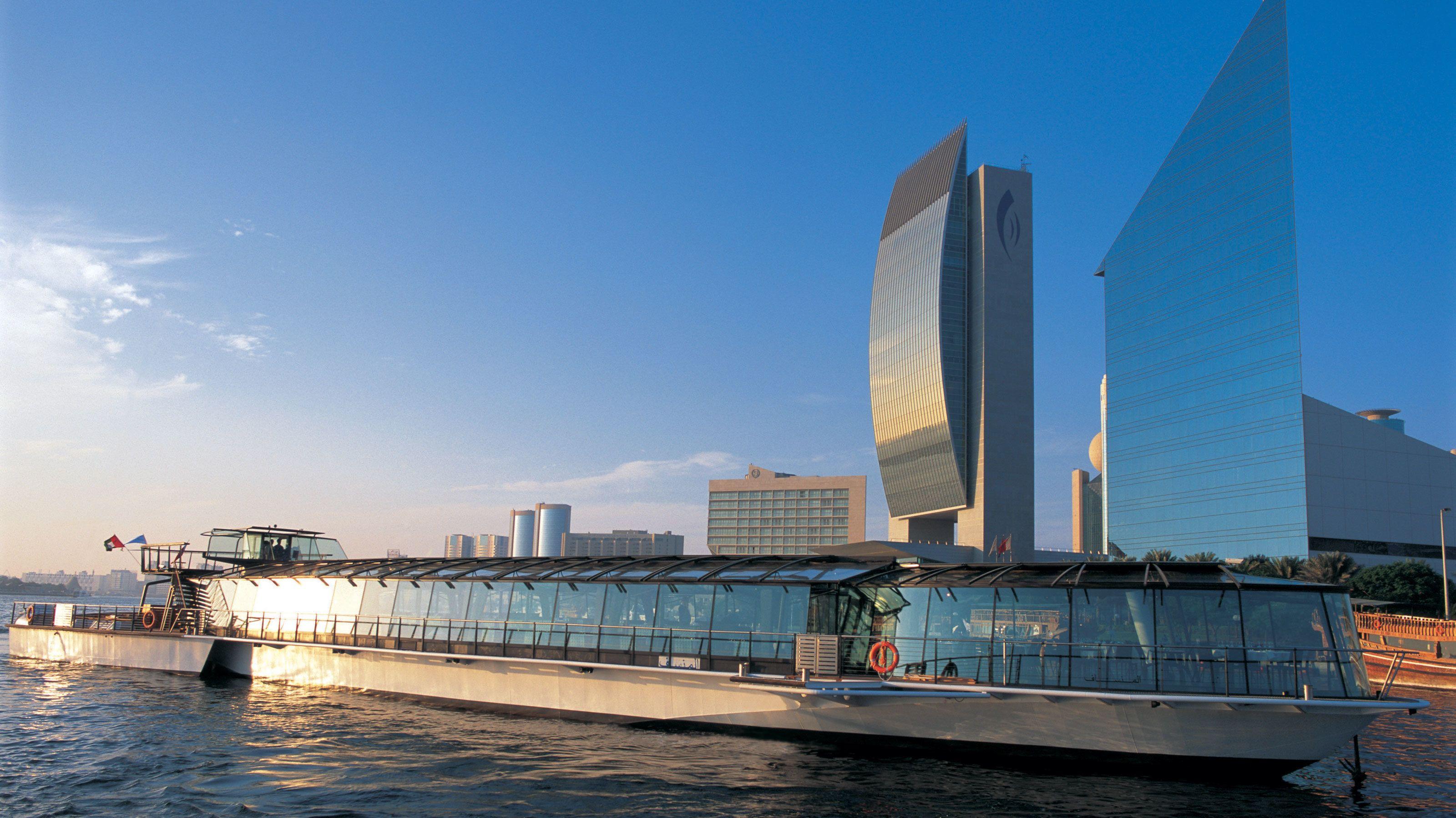 tour boat with glass windows in Dubai harbor