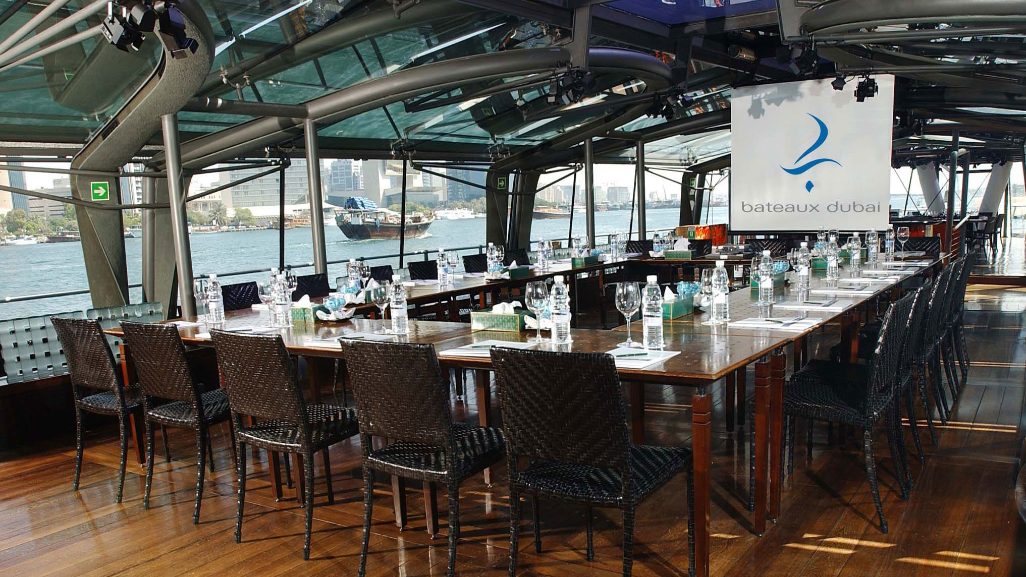 dinner table set for guests aboard boat in Dubai