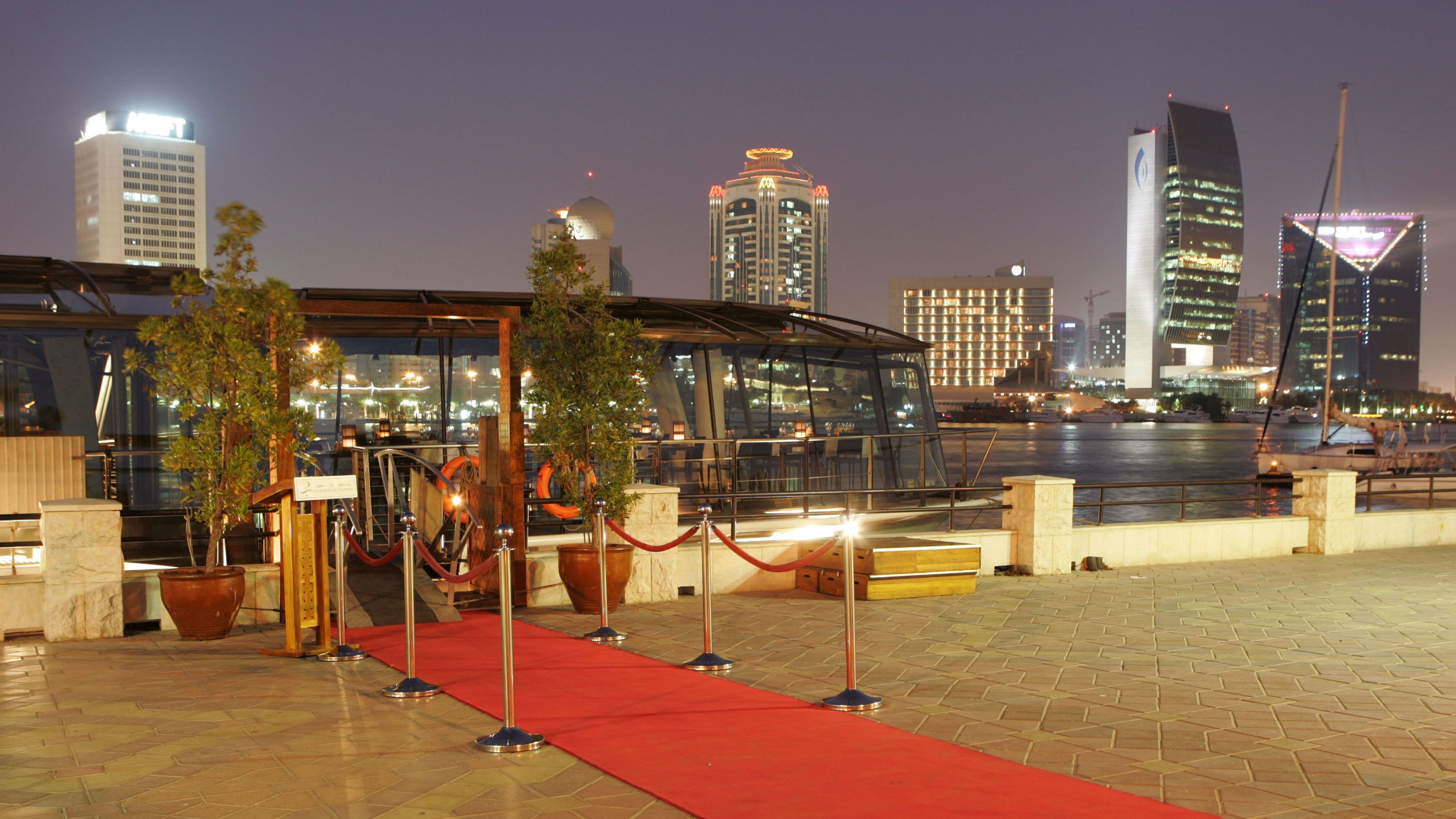 red carpet leading to tour boat in Dubai
