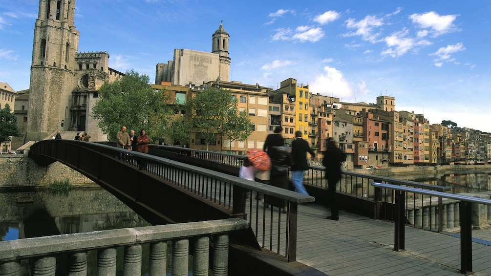 Show item 3 of 5. people walking over bridge in town of figueres girona in Barcelona