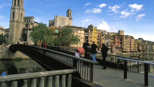 people walking over bridge in town of figueres girona in Barcelona