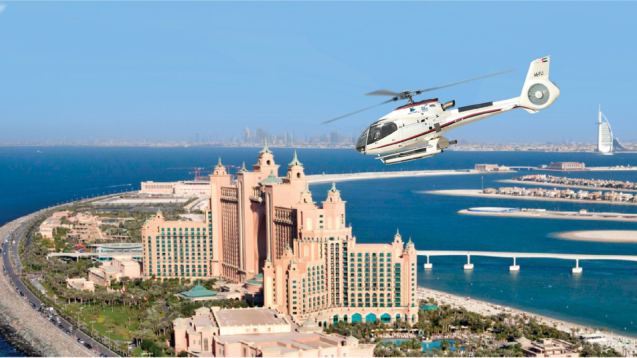 helicopter flying above Atlantis hotel in Dubai