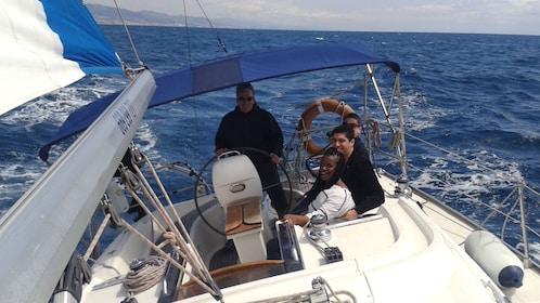 man sailing yacht on Mediterranean in Barcelona