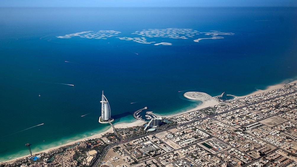 Apri foto 5 di 5.  Burj Al Arab hotel and city seen from far above in Dubai