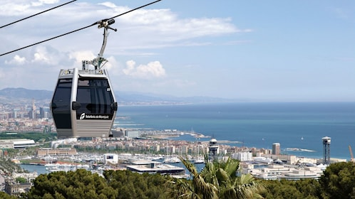 cable cars riding far above ground in Barcelona
