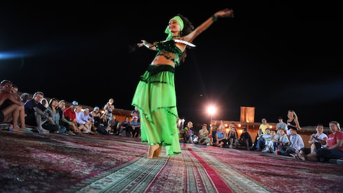 Arabic dancer performing for group of people at bedouin camp in Duabia