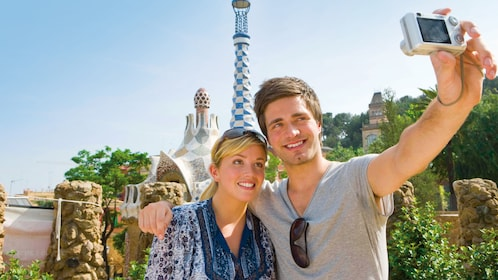 man and woman taking selfie at Park Guell, in Barcelona