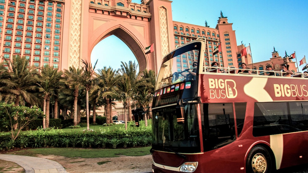 Show item 1 of 10. double decker tour bus outside the Atlantis hotel in Dubai