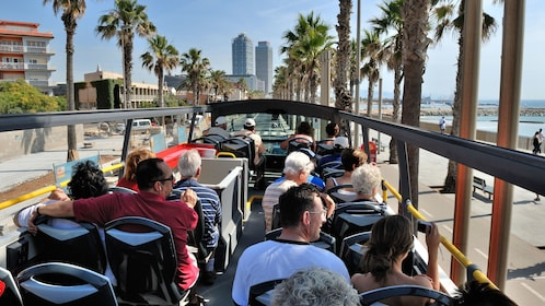 passengers on open air tour bus in Barcelona