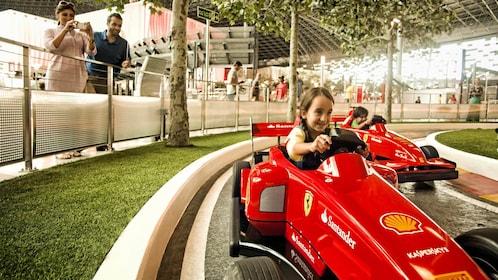 young girl racing Ferrari go-cart in Abu Dhabi Ferrari world