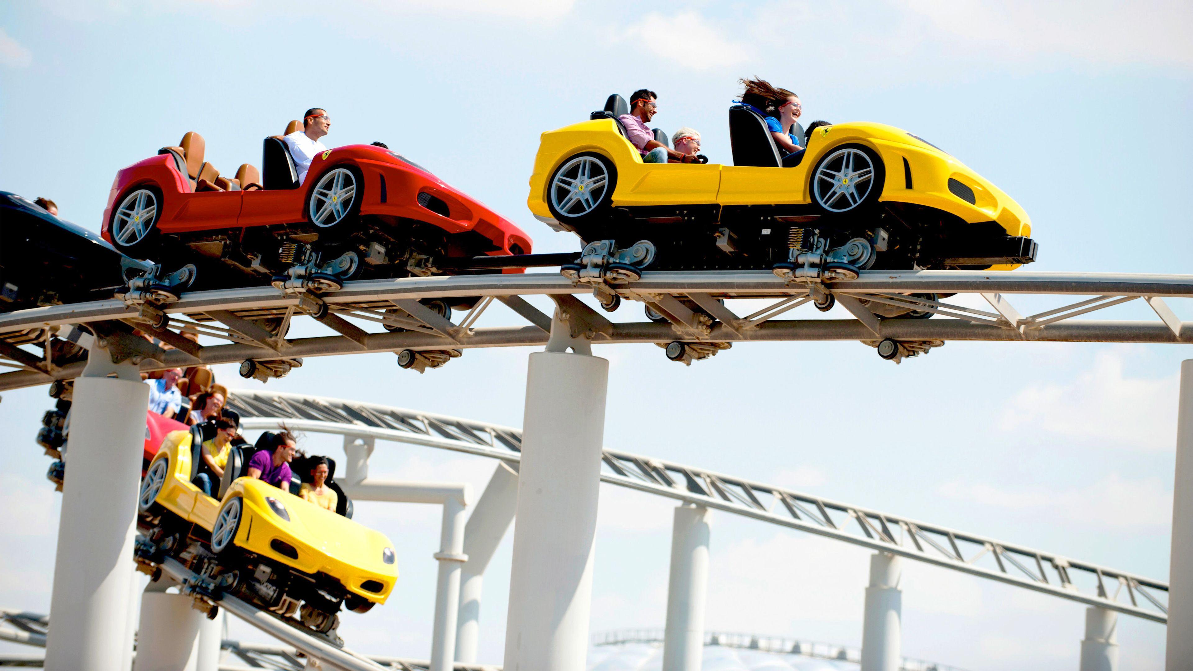 people in car shaped roller coaster in Dubai