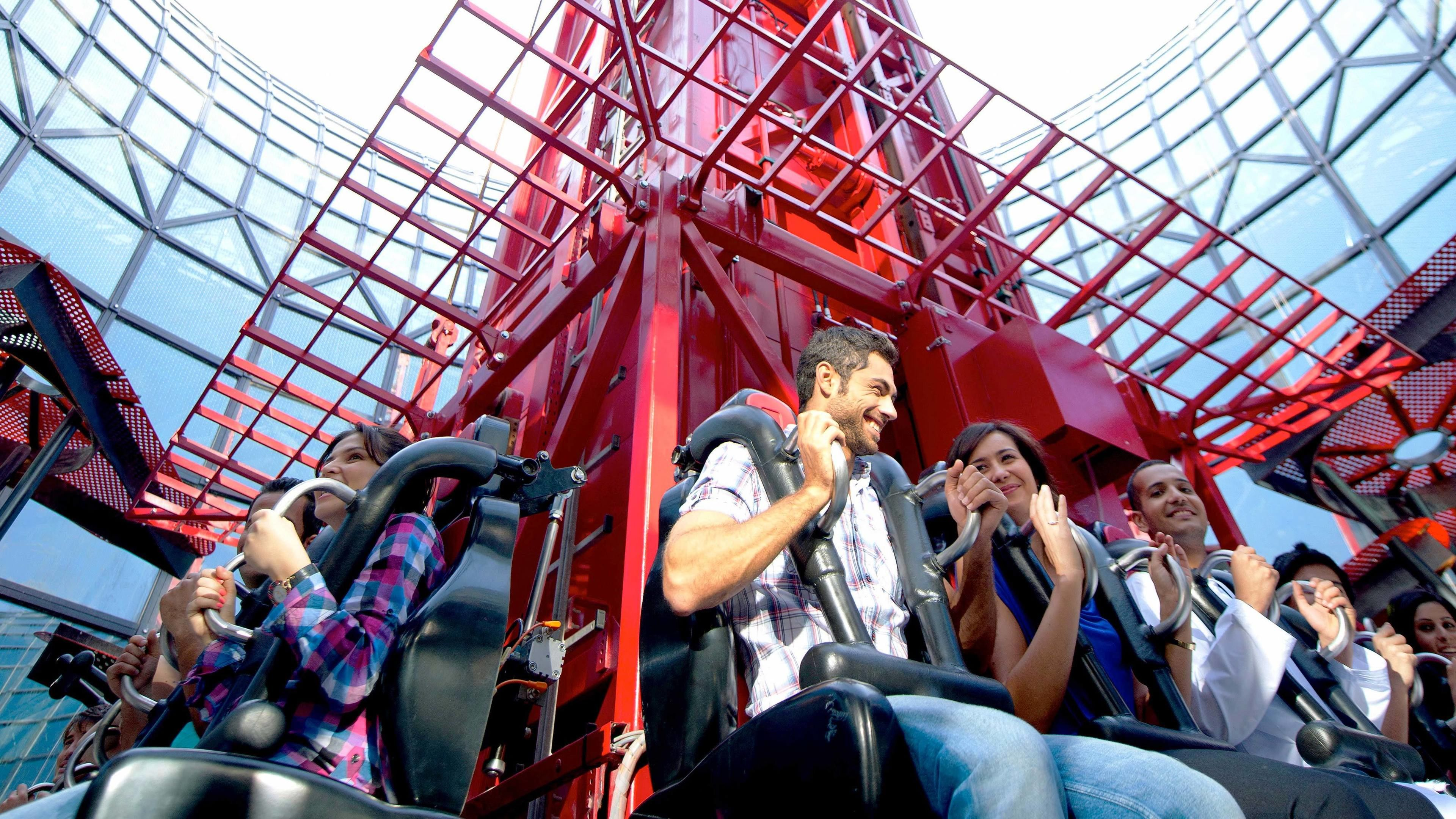 people strapped into ride at theme park in Dubai