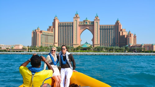 couple gets picture taken by Atlantis hotel in Dubai
