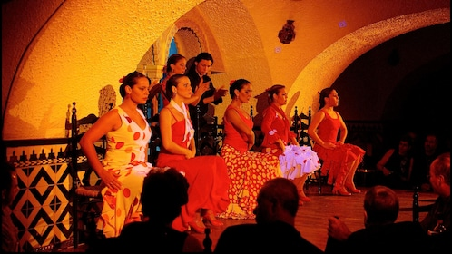 women Flamenco dancers seated before audience in Barcelona