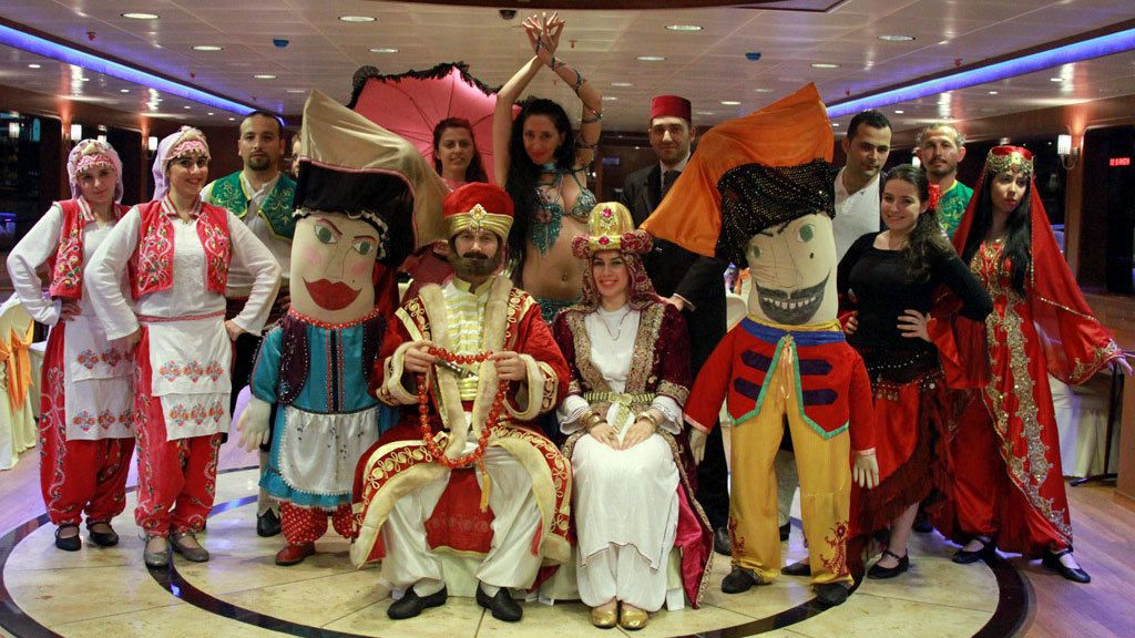 Group of performers take a group picture at the Bosphorus Dinner Cruise