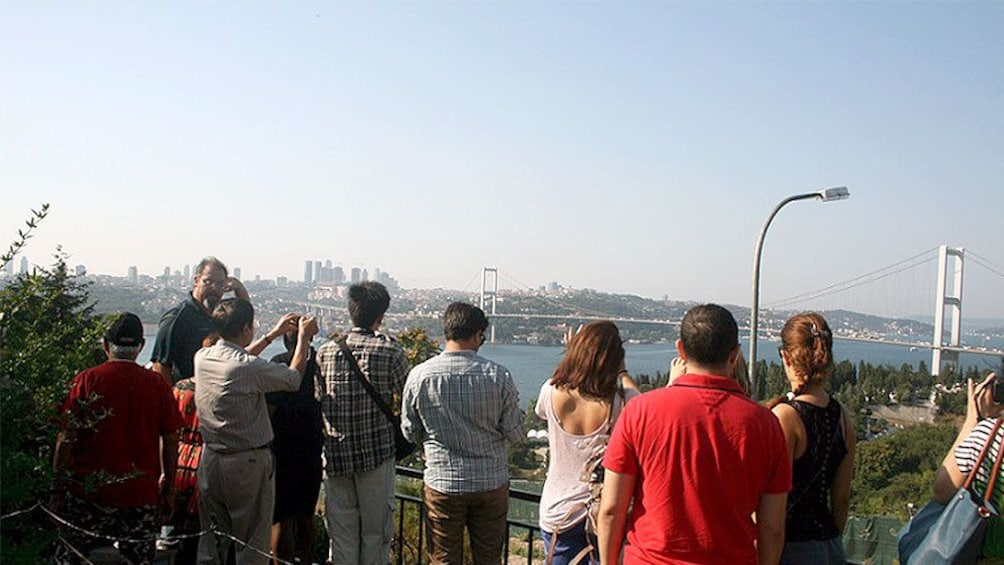 Tour group taking a picture of the cityscape of Istanbul